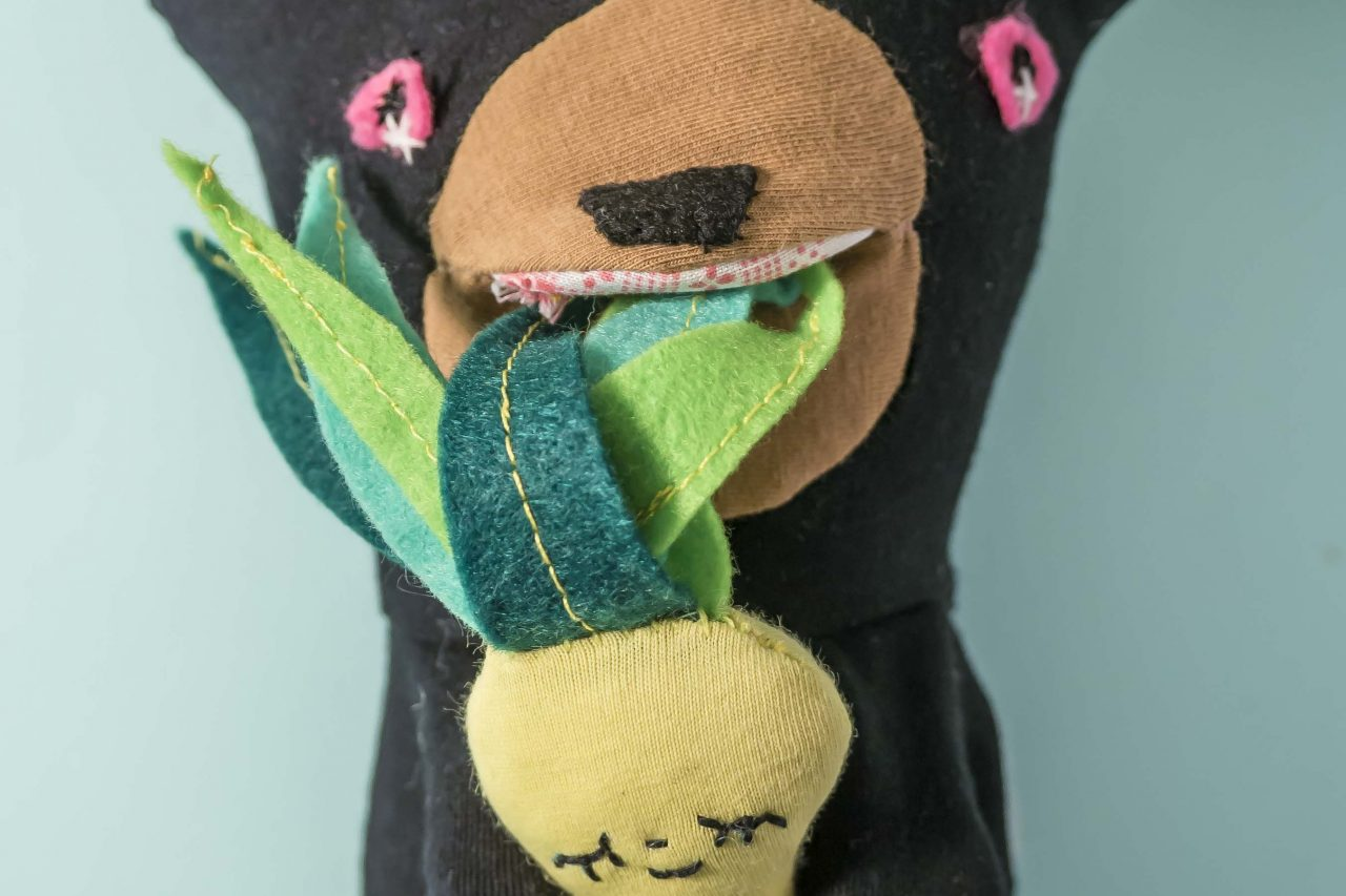 baxter black bear doll munching