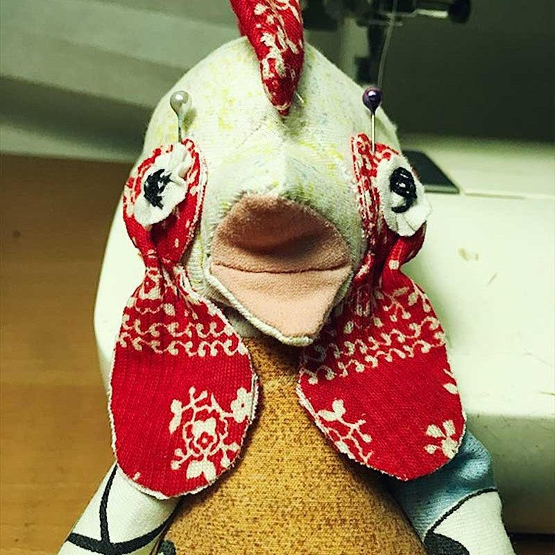 rooster plush face close up