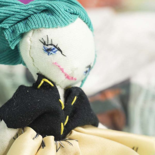 soft posable pocket doll of a mighty girl with a smile close up