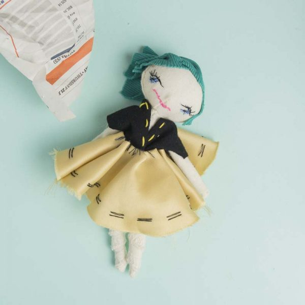 soft posable pocket doll of a mighty girl with a smile full body