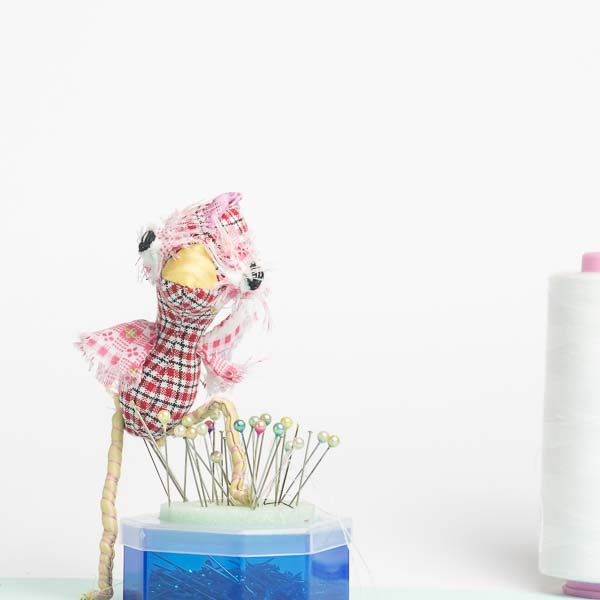 Clara the chicken pocket doll has skinny posable legs