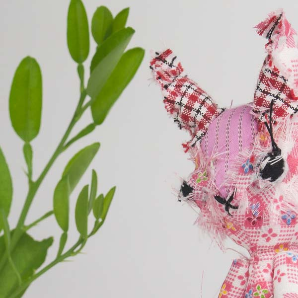 "Ruth the hare is a pink posable 6"" dolly for play"