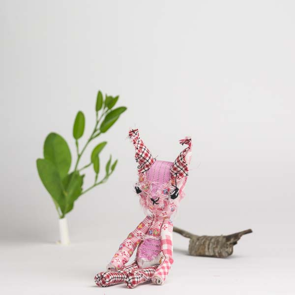 """Ruth the hare is a pink posable 6"""" dolly for play"""