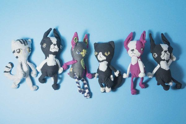 group of handmade dolls of boston terriers and cats