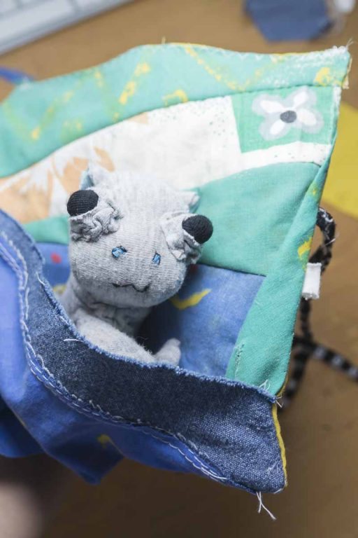 baby hippo fabric doll peering out of its sleeping bag