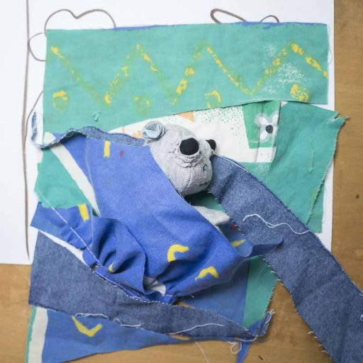 WIP improv doll quilt sleeping bag containing a baby hippo textile doll