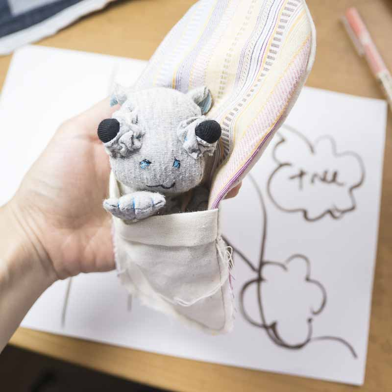 handmade hippo baby doll in a sleeping bag