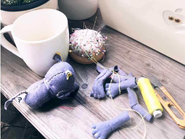 half sewn rhino textile doll