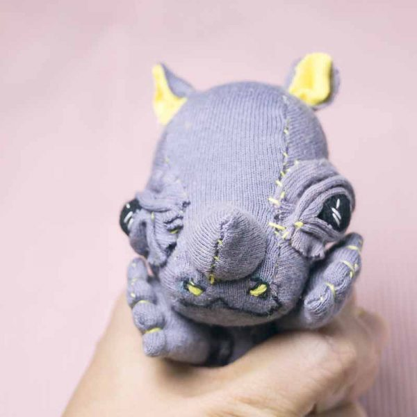 handmade fabric doll of a baby rhinoceros