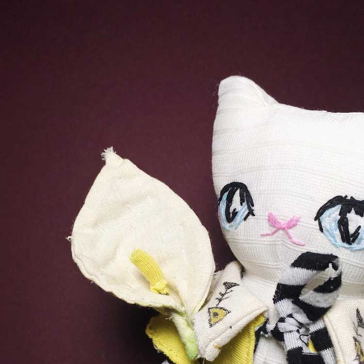 handmade kitty cat doll with a calla lily flower