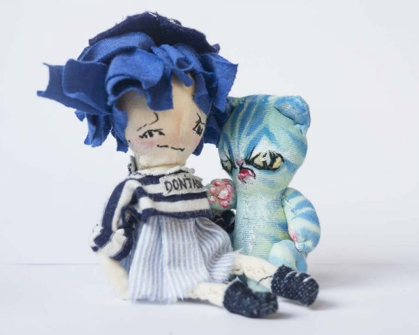 blue hair pocket girl doll with turquoise striped alien cat