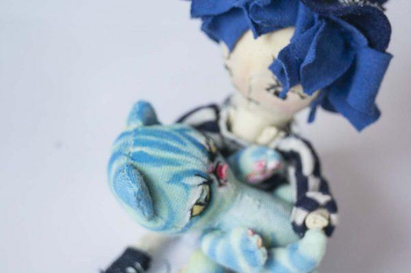 handmade artist girl doll with miniature turquoise evil tabby cat