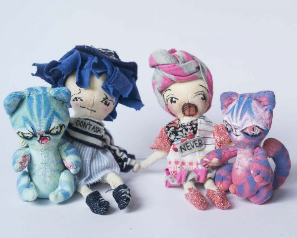 group of 2 girls and 2 alien cats all handmade artist dolls using reclaimed cotton