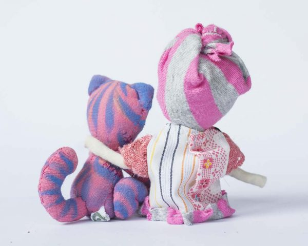 back view of pink and purple girl and cat sitting dolls