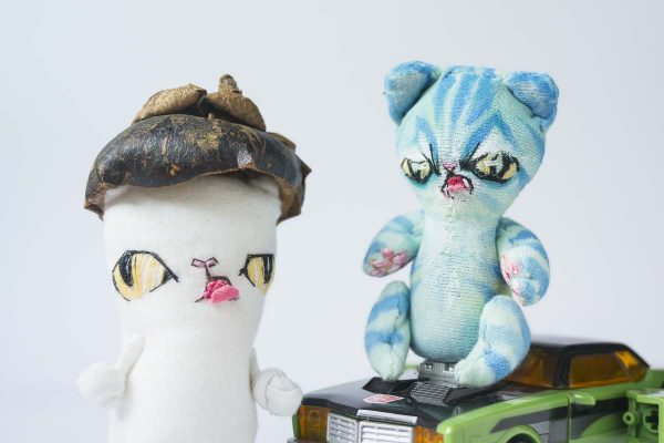 white exotic short hair cat with alien tuqyoise striped tabby cat in the great cat battle scene - doll photo using handmade artist plushie ooak