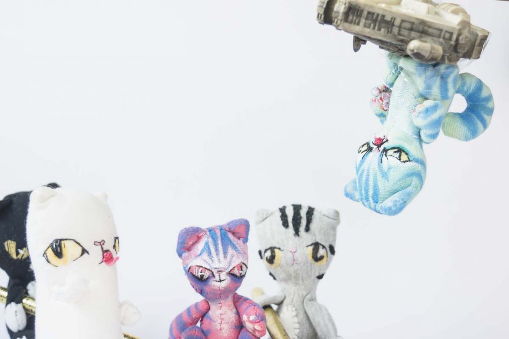 alien cats invaded earth, earth cats defending the line in the great cat doll battle.
