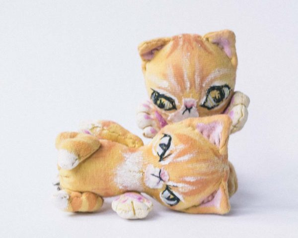 embroidered features and handpainted stripes on pocket sized ginger tabby cat dolls