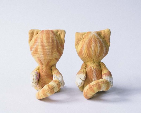 backview shoing the stripes of these small dollhouse size cat dolls, good as blythe's friend too
