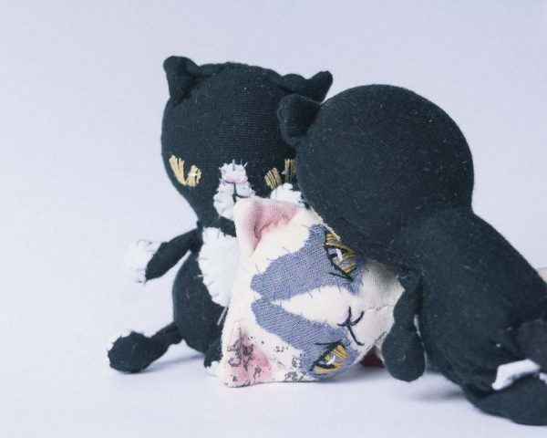 cat snuggling pocket dolls by doll artist