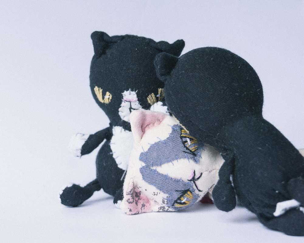 cat snuggling pocket dolls by doll artist