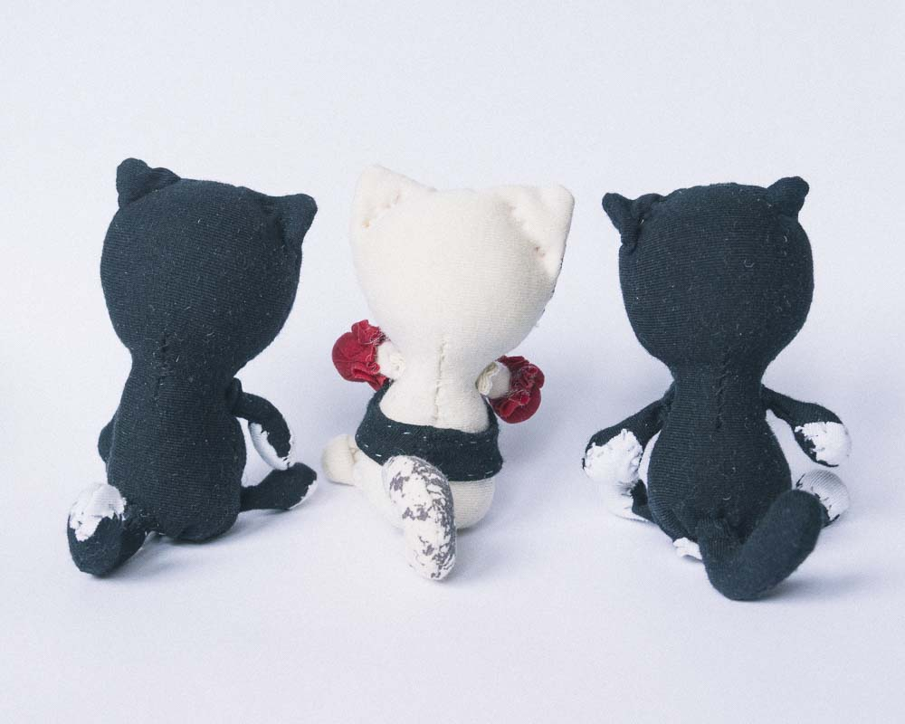 back of 3 handmade cat dolls