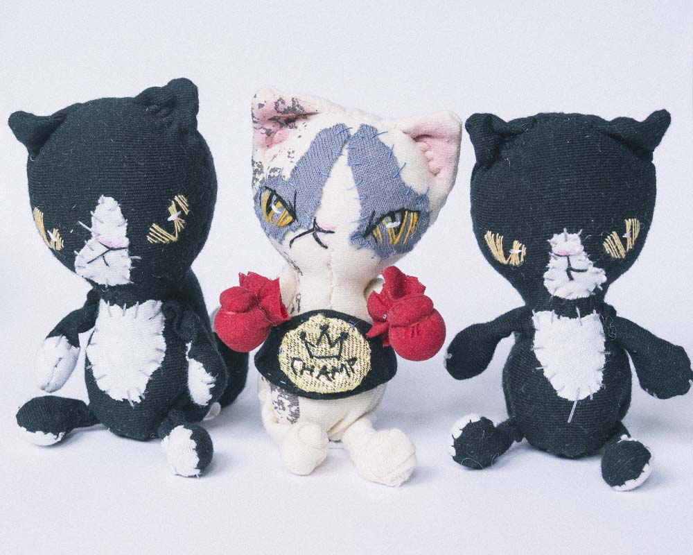 three bad cat dolls handsewn by doll artist