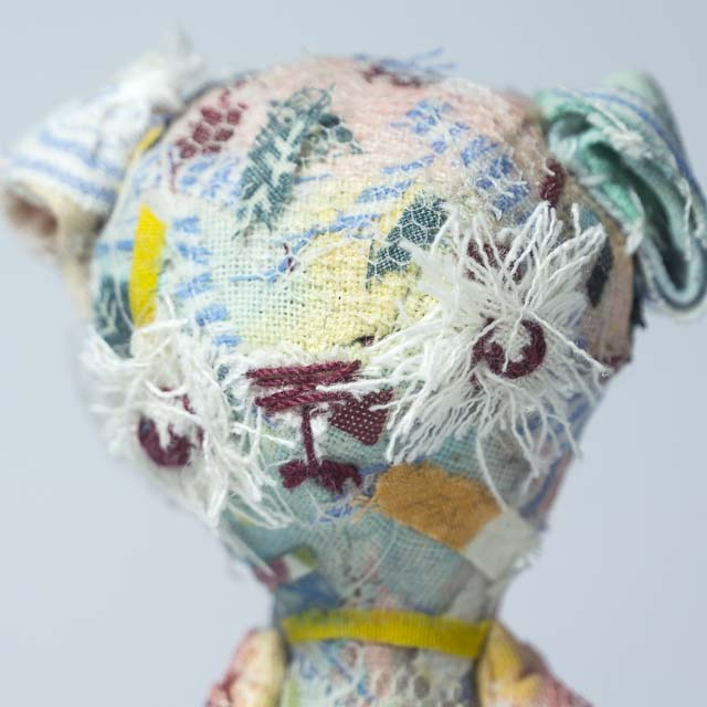 a philosopher bear in multicolor collage