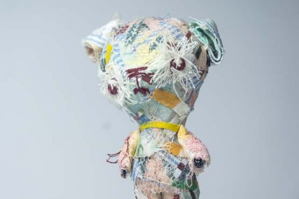 ponderous multicoloured fabric teddy bear by doll artist