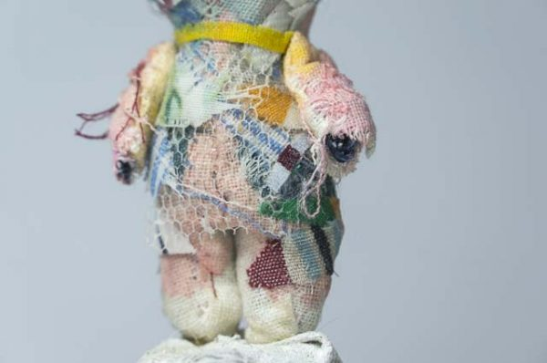 close up of fabric collage teddy bear - granite