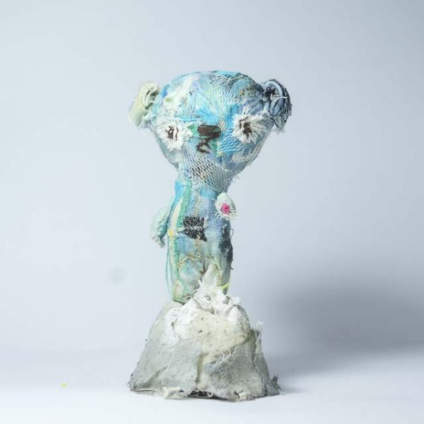 a little blue green bear has scaled the heights - tiny art doll