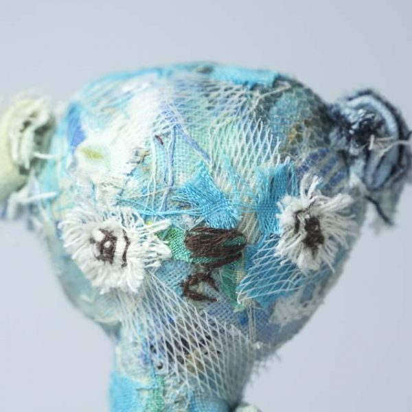 turquoise teddy bear made of a fabric collage -handmade artist doll