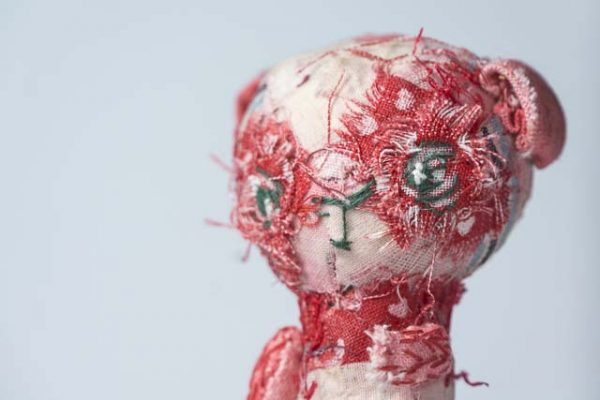 a determined little panda doll in red by doll artist