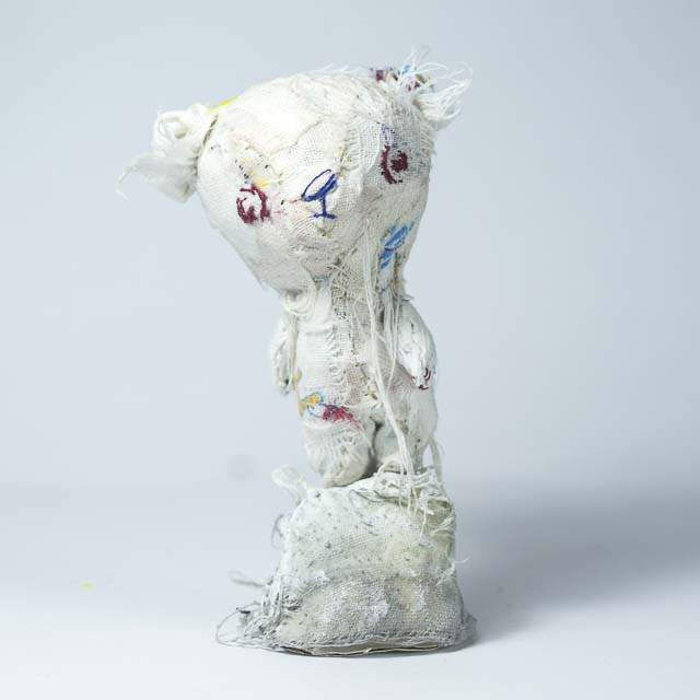 tiny teddy bear in white with hand embroidered face