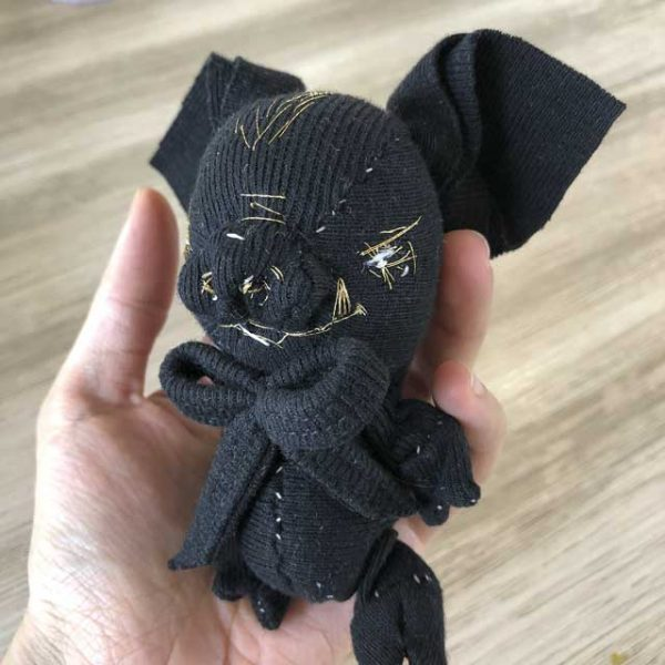 3/4 view of a black wild piglet handmade eco toy pig plushie