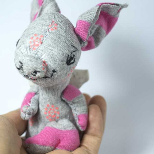 pink and grey smiling piglet artist dolls