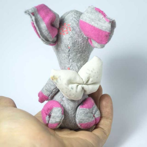 view of the back of a piggy doll with wings
