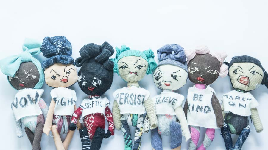 a group of 7 mighty girl dolls, hand stitched from old clothes, free hand embroidered facial expressions. Each on is one of a kind 100% recycled fabric.