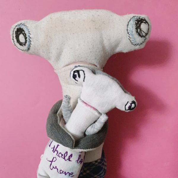 big hammerhead holding a small hammerhead upcycled textile art doll, embroidery says 'i shall be brave'