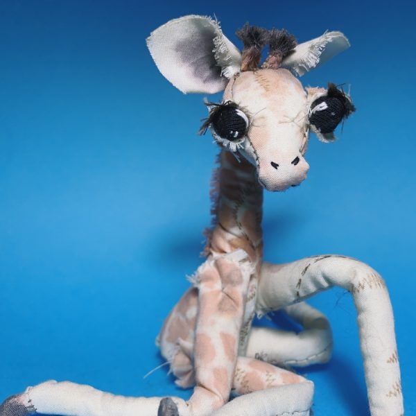 big eyes giraffe textile artist doll stitched withe recycled fabric sits upright