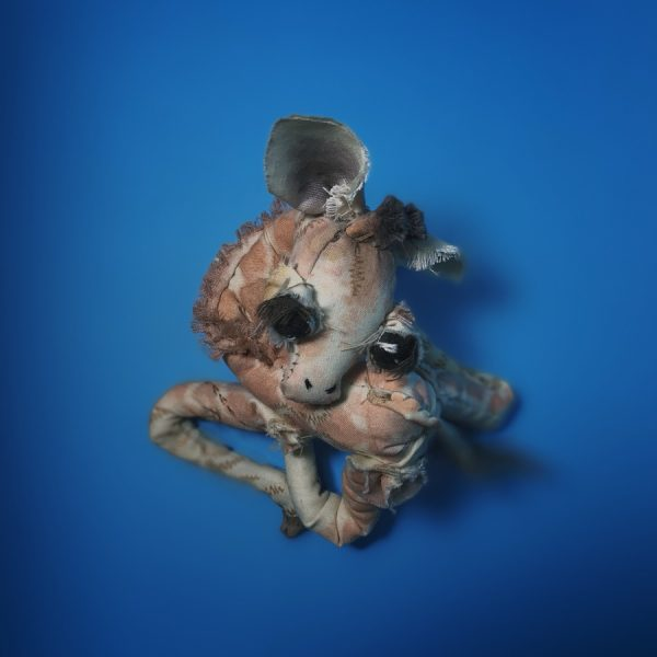 giraffe artist textile doll curled up sleeping, made of upcycled cloth