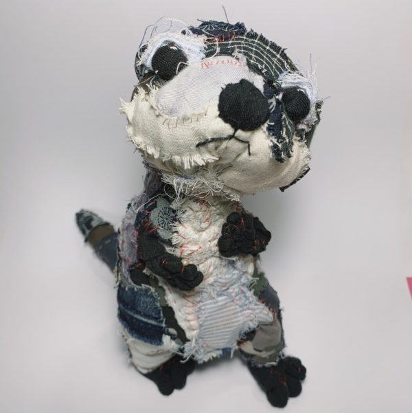 fabric otter art doll looking quizzical