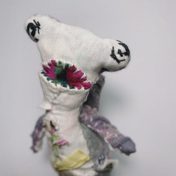 slow stitched textile art doll from recycled fabric of a hammerhead shark with its mouth opened