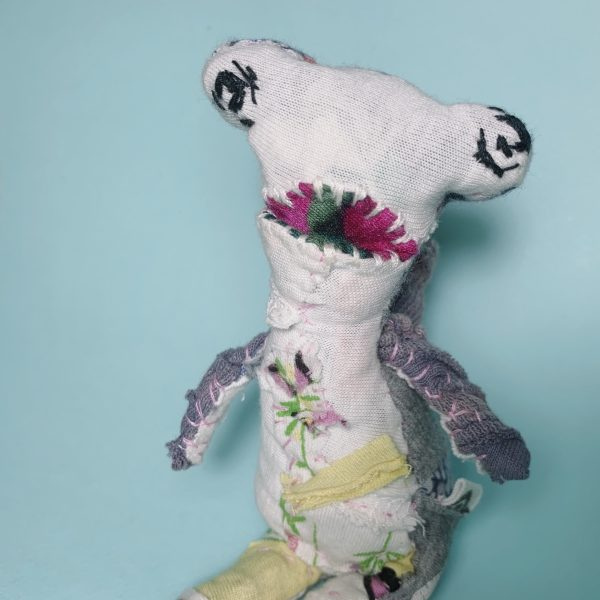 hammerhead shark textile art doll slowstitched from upcycled fabric scraps showing strength and vulnerability