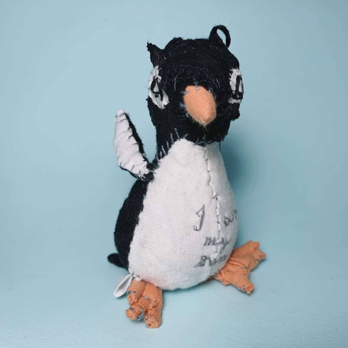 penguin textile art doll slow stitched and visible mending from recycled old clothes
