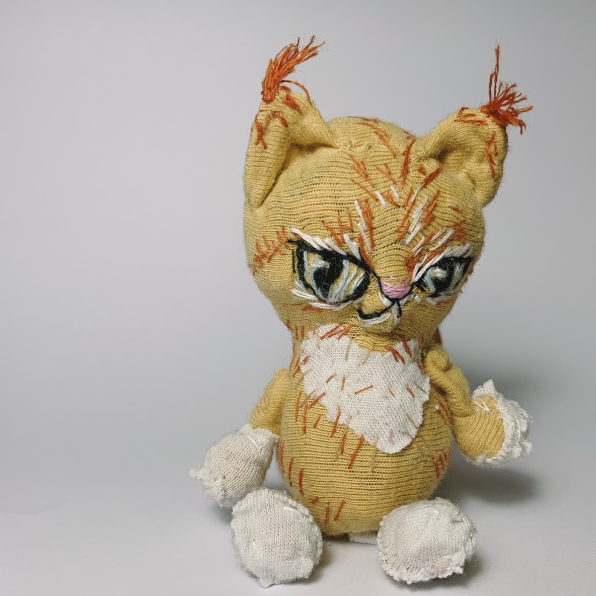 philospher ginger tabby cat soft sculpture