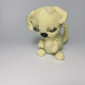 Yellow retriever puppy dog soft sculpture looking like a sad puppy