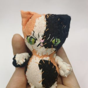 evil papaya calico cat textile art doll