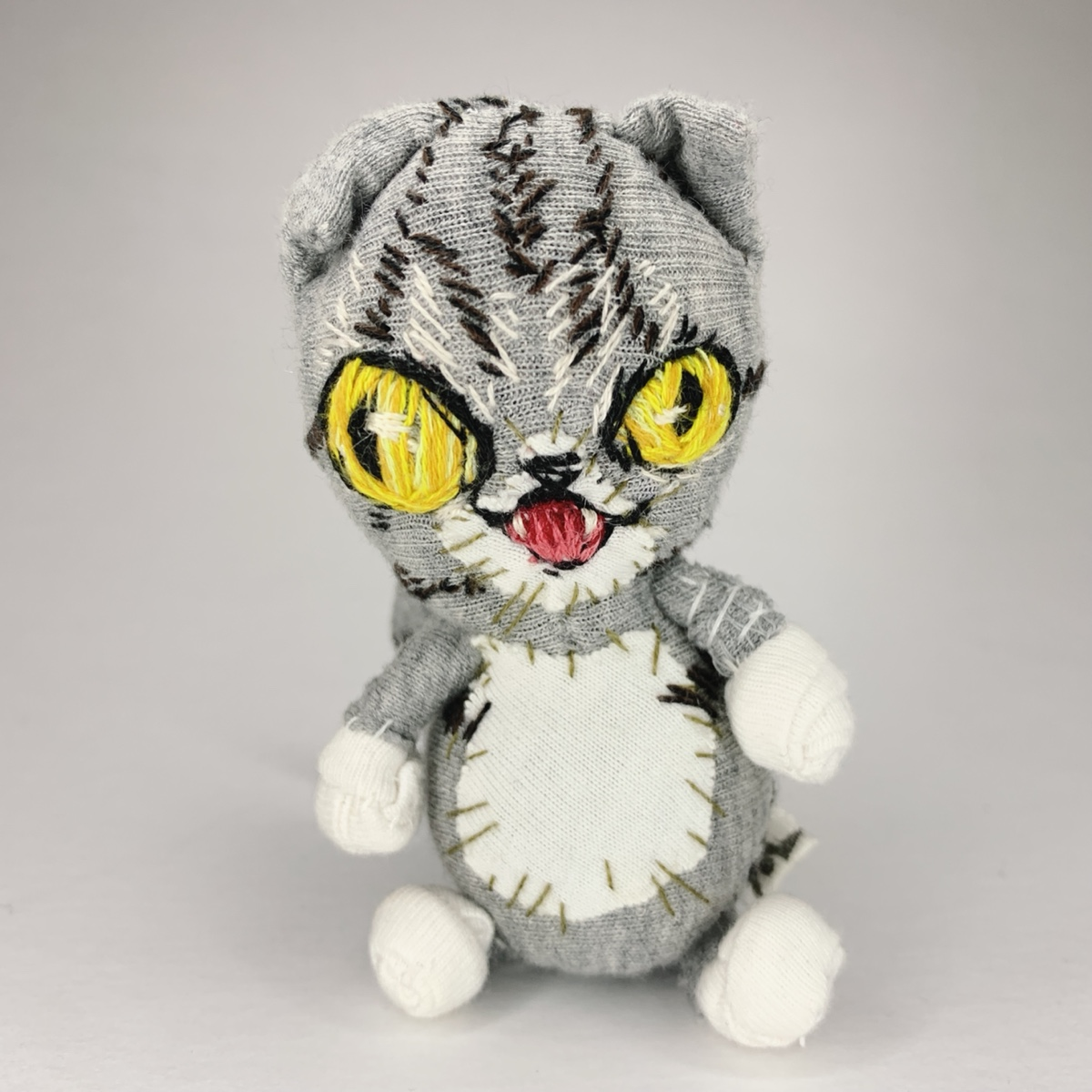 a grey tabby cat soft sculpture hand stitched from recycled materials